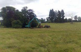 Long reach excavator at work at Hanbury Hall